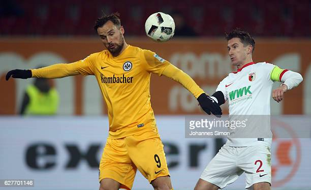 Paul Verhaegh of Augsburg fights for the ball with Haris Seferovic of Frankfurt during the Bundesliga match between FC Augsburg and Eintracht...