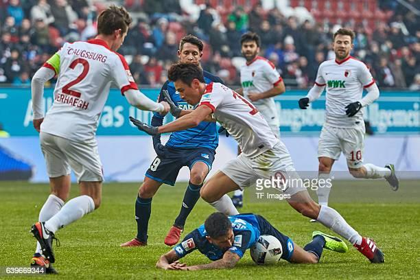 Paul Verhaegh of Augsburg Mark Uth of 1899 Hoffenheim Steven Zuber of 1899 Hoffenheim and JaCheol Koo of Augsburg battle for the ball during the...