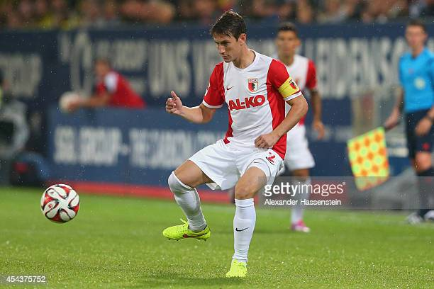 Paul Verhaegh of Augsburg runs with the ball during the Bundesliga match between FC Augsburg and BVB Borussia Dortmund at SGL Arena on August 29 2014...