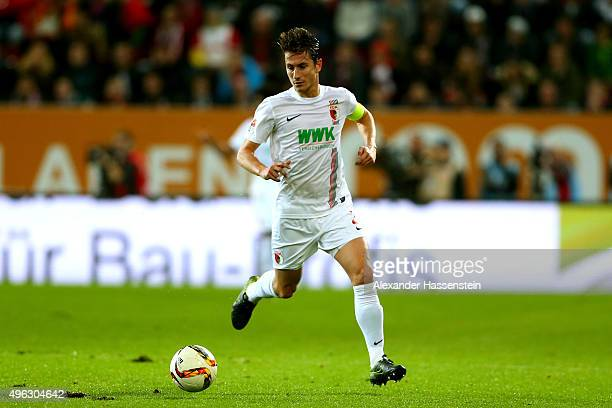 Paul Verhaegh of Augsburg runs with the ball during the Bundesliga match between FC Augsburg and SV Werder Bremen at WWK Arena on November 8 2015 in...