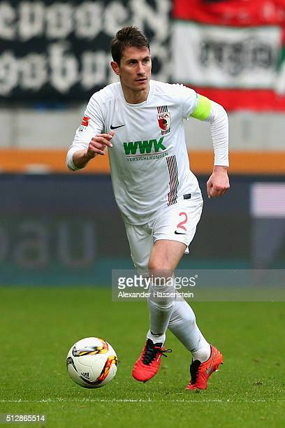 Paul Verhaegh of Augsburg runs with the ball during the Bundesliga match between FC Augsburg and Borussia Moenchengladbach at WWK Arena on February...