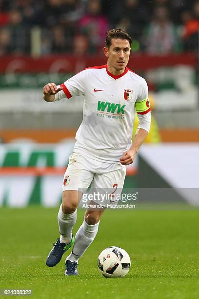 Paul Verhaegh of Augsburg runs with the ball during the Bundesliga match between FC Augsburg and Hertha BSC at WWK Arena on November 19 2016 in...