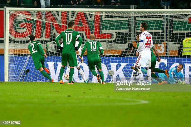 Paul Verhaegh of Augsburg scores the 3rd team goal with a penalty against Jaroslav Drobny keeper of Hamburg during the Bundesliga match between FC...