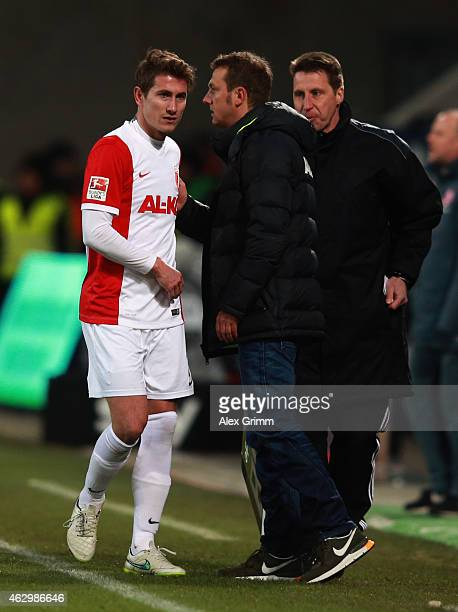 Paul Verhaegh of Augsburg walks past head coach Markus Weinzierl after being substituted during the Bundesliga match between FC Augsburg and...