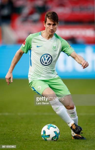 Paul Verhaegh of Wolfsburg runs with the ball during the Bundesliga match between Bayer 04 Leverkusen and VfL Wolfsburg at BayArena on October 15...
