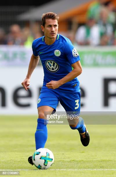 Paul Verhaegh of Wolfsburg runs with the ball during the DFB Cup first round match between FC Eintracht Norderstedt and VfL Wolfsburg at...