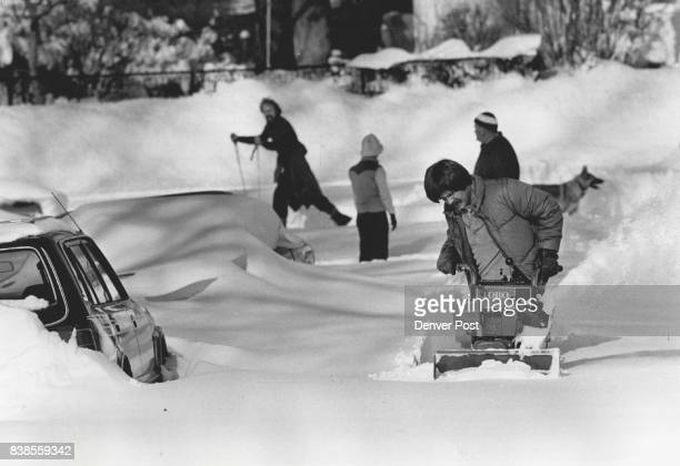 Paul Vodel at 195 Downing Stoperates a snow blower to help get his dad's cars out see 2 on left skier is moving in the background Credit The Denver...