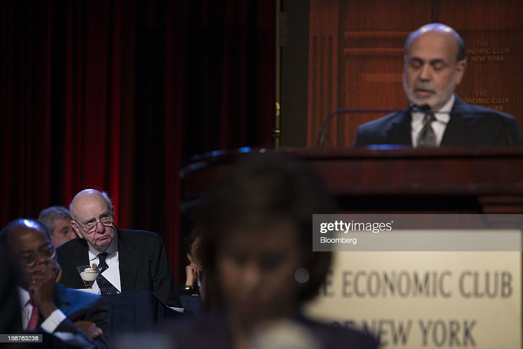 Paul Volcker, former chairman of the U.S. Federal Reserve, left, listens as Ben S. Bernanke, chairman of the U.S. Federal Reserve, unseen, speaks to the Economic Club of New York in New York, U.S., on Tuesday, Nov. 20, 2012. Bernanke said that an agreement on ways to reduce long-term federal budget deficits could remove an impediment to growth, while failure to avoid the so-called fiscal cliff would pose a 'substantial threat' to the recovery. Photographer: Scott Eells/Bloomberg via Getty Images