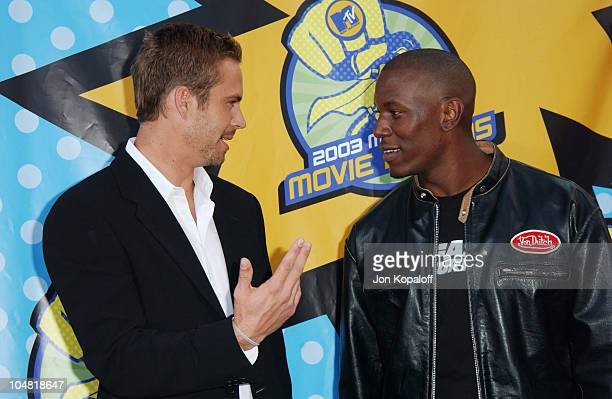 Paul Walker and Tyrese during 2003 MTV Movie Awards Arrivals at The Shrine Auditorium in Los Angeles California United States