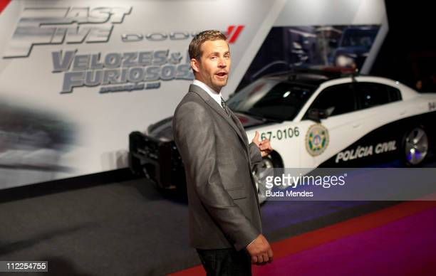 Paul Walker poses for photographers during the premiere of the movie 'Fast and Furious 5' at Cinepolis Lagoon on April 15 2011 in Rio de Janeiro...