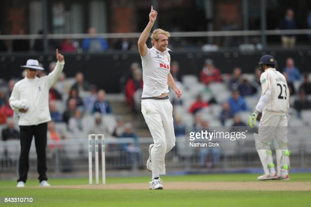 Paul Walter of Essex celebrates after taking the wicket of Shivnarine Chanderpaul of Lancashire out during the County Championship Division One match...