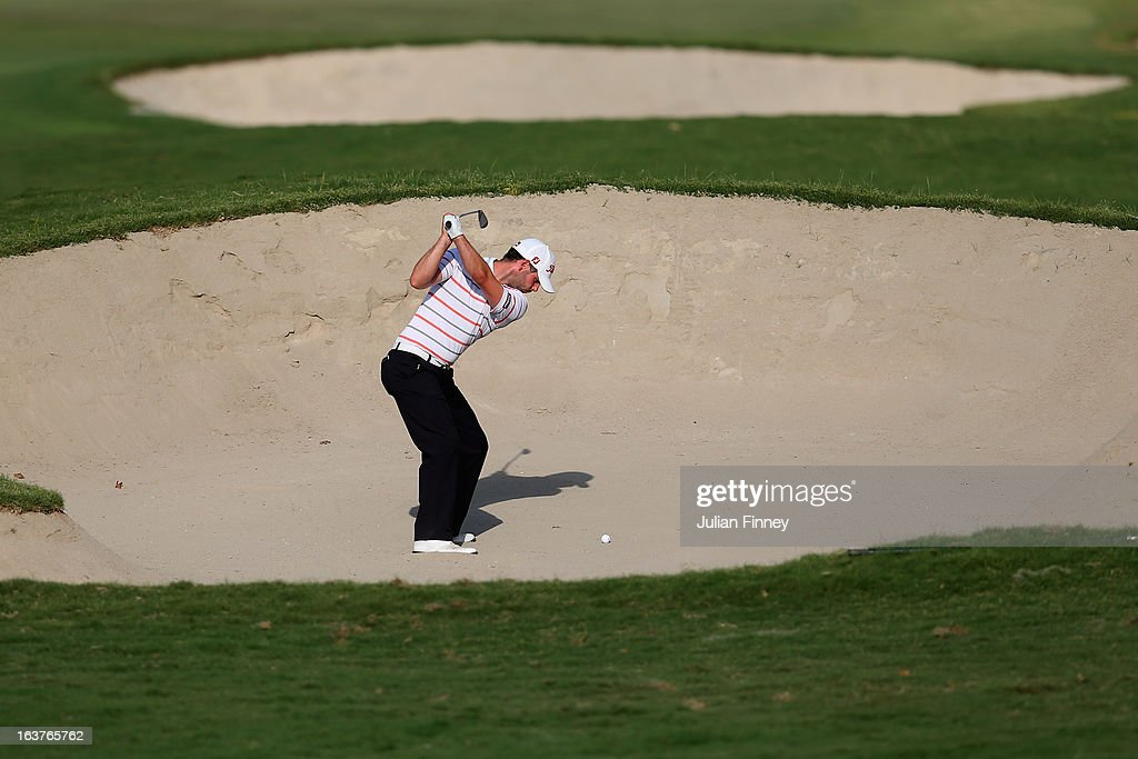 Paul Waring of England plays out of a bunker during day two of the Avantha Masters at Jaypee Greens Golf Club on March 15, 2013 in Delhi, India.