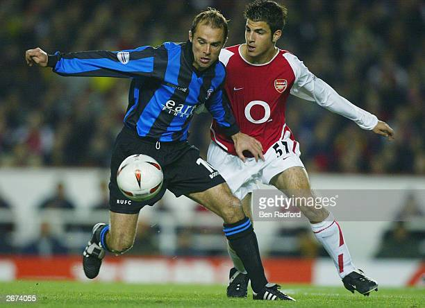 Paul Warne of Rotherham United battles for the ball with Francesc Fabregas of Arsenal during the Carling Cup Third Round match between Arsenal and...