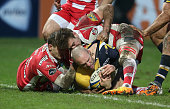 Paul Warwick of Worcester is held up just short of the try line by the Gloucester defence during the Aviva Premiership match between Gloucester and...
