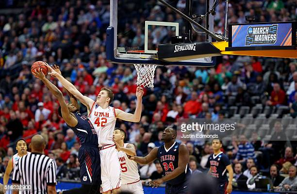 Paul Watson of the Fresno State Bulldogs goes up against Jakob Poeltl of the Utah Utes in the first half during the first round of the 2016 NCAA...
