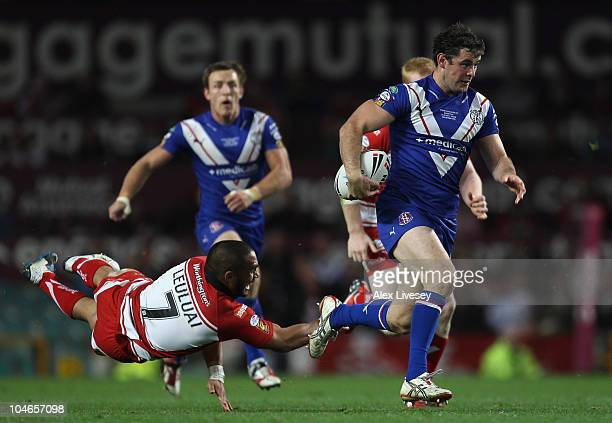 Paul Wellens of St Helens beats Thomas Leuluai of Wigan Warriors during the engage Super League Grand Final between St Helens and Wigan Warriors at...