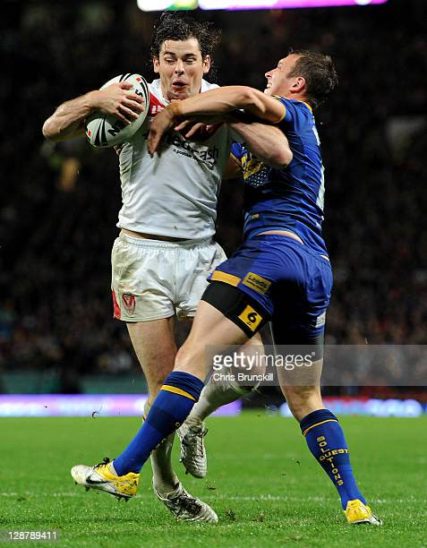 Paul Wellens of St Helens is tackled by Danny McGuire of Leeds Rhinos during the Engage Super League Grand Final match between St Helens and Leeds...