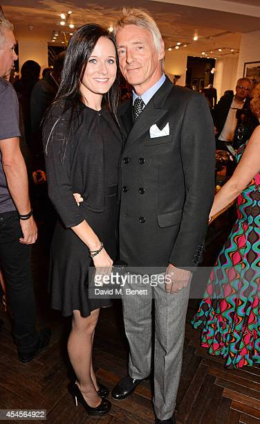 Paul Weller and Hannah Andrews attend as John Varvatos launch their first European store in London on September 3 2014 in London England