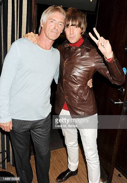 Paul Weller and Miles Kane attend as The Stone Roses perform a secret gig at adidas Underground on August 6 2012 in London England