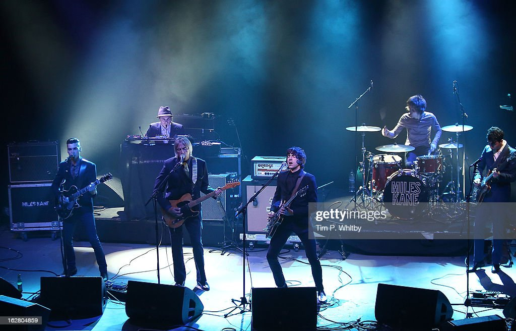 Paul Weller and Miles Kane perform during at the NME Awards 2013 at the Troxy on February 27, 2013 in London, England.