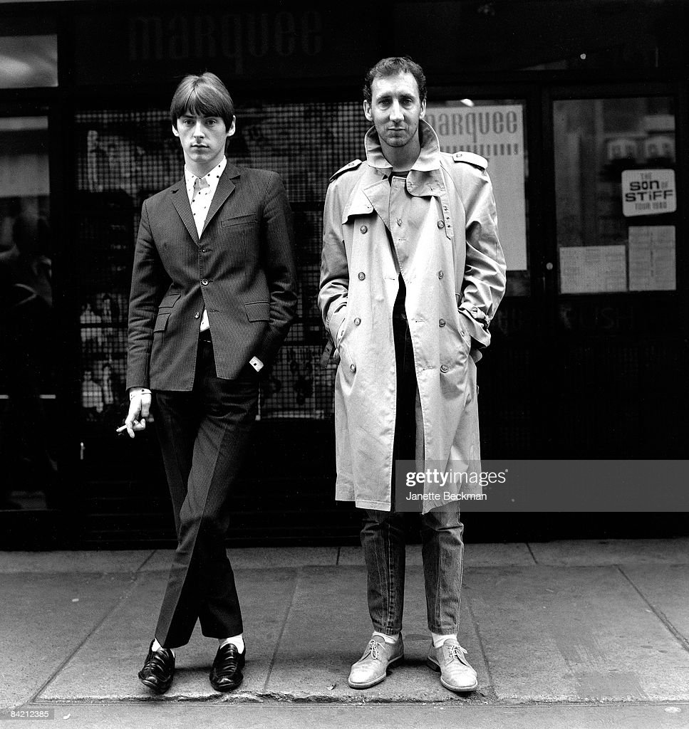 ) Paul Weller (b.1958) modfather and co-founder of 'The Jam' stands next to a fellow British rock icon, Pete Townshend (b.1945) guitarist for 'The Who', in the Soho neighborhood of London, 1980. United Kingdom.