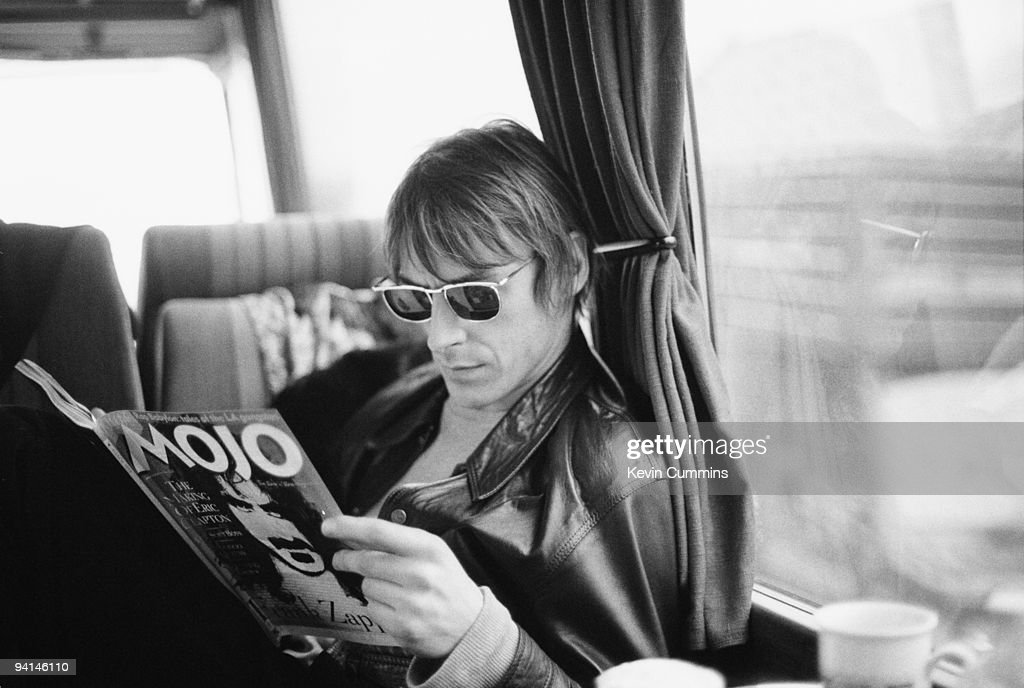 Paul Weller on his tour bus reading a copy of music magazine 'Mojo', Ireland, Feb/March 1994