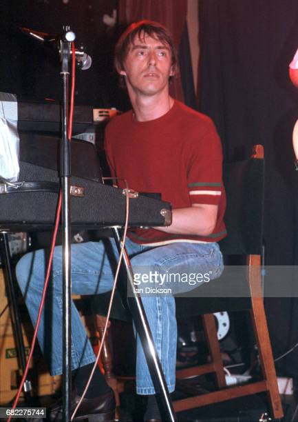 Paul Weller performing on stage playing keyboards with Ocean Colour Scene at Splash Club Kings Cross London 18 March 1994
