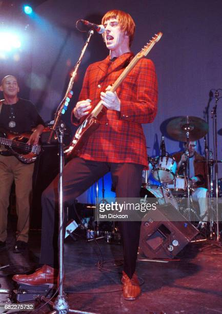 Paul Weller performing on stage with Camelle Hinds and Steve White at The Forum Kentish Town London 11 March 1993