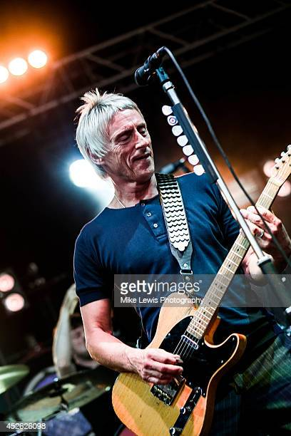 Paul Weller performs on stage at Cardiff Castle on July 24 2014 in Cardiff United Kingdom