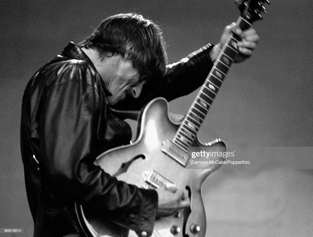 FESTIVAL Photo of Paul WELLER, B&W, performing live onstage, playing Epiphone Casino guitar