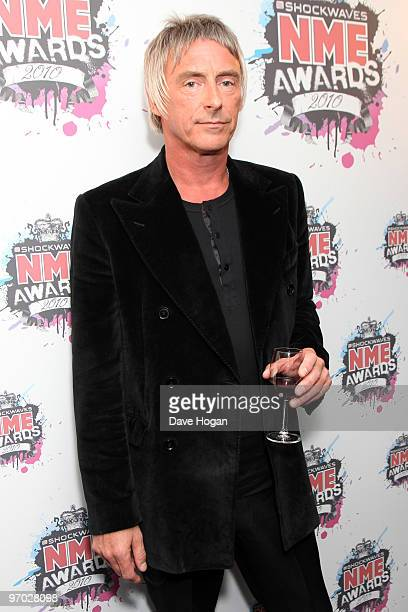 Paul Weller poses in front of the winners boards at the Shockwaves NME Awards 2010 held at Brixton Academy on February 24 2010 in London England