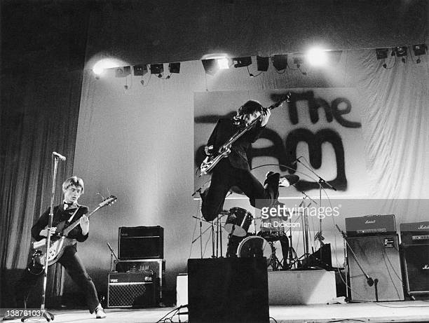 Paul Weller Rick Buckler Bruce Foxton performing live onstage with The Jam logo on backdrop behind 13th June 1977