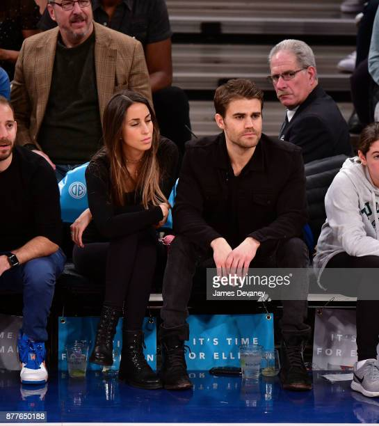 Paul Wesley and guest attend the Toronto Raptors Vs New York Knicks game at Madison Square Garden on November 22 2017 in New York City