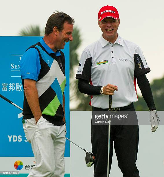 Paul Wesselingh and Gary Wolstenholme of England chat and joke before starting play on the tenth tee during day one of the Fubon Senior Open at...