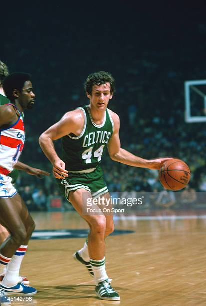 Paul Westphal of the Boston Celtics drives on Kevin Porter of the Washington Bullets during an NBA basketball game circa 1975 at the Capital Centre...