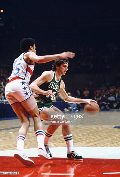 Paul Westphal of the Boston Celtics drives on Phil Chenier of the Washington Bullets during an NBA basketball game circa 1975 at the Capital Centre...