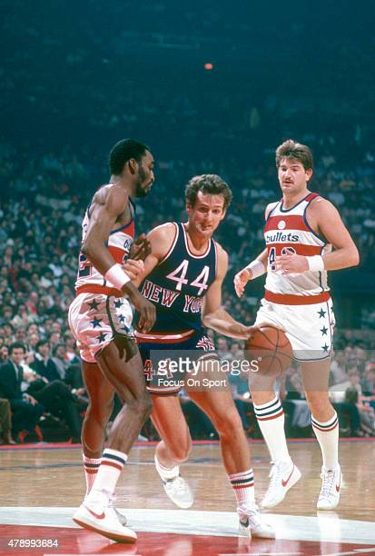 Paul Westphal of the New York Knicks drives on Don Collins of the Washington Bullets during an NBA basketball game circa 1982 at the Capital Centre...