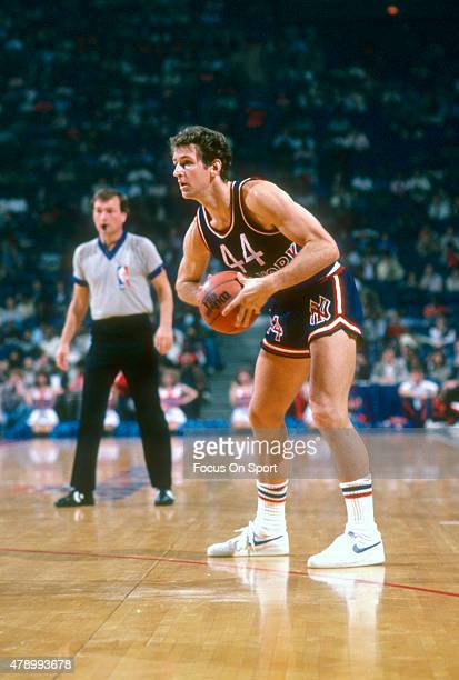 Paul Westphal of the New York Knicks looks to pass the ball against the Washington Bullets during an NBA basketball game circa 1982 at the Capital...