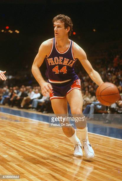 Paul Westphal of the Phoenix dribbles the ball against the New Jersey Nets during an NBA basketball game circa 1978 at the Rutgers Athletic Center in...