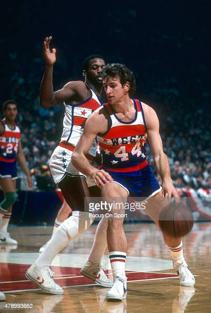 Paul Westphal of the Phoenix Suns and the West All Stars dribbles the ball against the East All Stars during the NBA All Star Game February 3 1980 at...