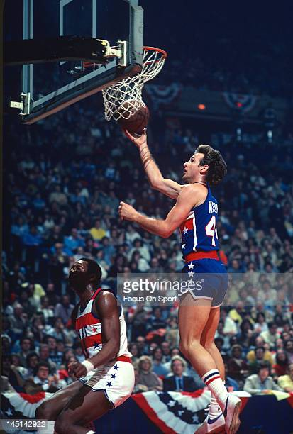 Paul Westphal of the Phoenix Suns and the West All Stars goes up to shoot over Elvin Hayes of the Washington Bullets and the East All Stars during...