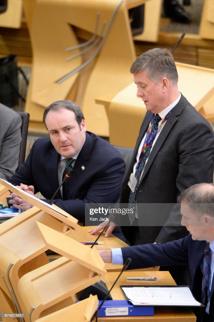 Paul Wheelhouse (L), Minister for Business, Innovation and Energy, listens as Economy Secretary Keith Brown (C) responds to a question on Scottish Government support for engineering company BiFab during Topical Questions in the Scottish Parliament, as the company faces the possibility of going into administration because of difficulties with a major contract, on November 14, 2017 in Methil, Scotland. Unions say staff have agreed to a 'work-in' - continuing to work to progress the orders in hand even though they may not be paid.