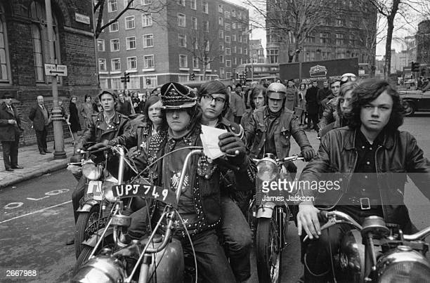 Paul Wilkins leader of the 'Devil's Henchmen' leads his motorcycle gang on a run delivering mail for the YMCA during a London postal strike