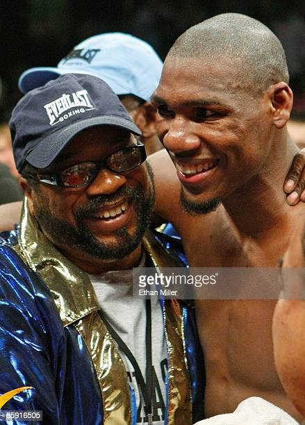 Paul Williams and his trainer George Peterson celebrate defeating Winky Wright in a unanimous decision in a middleweight bout at the Mandalay Bay...