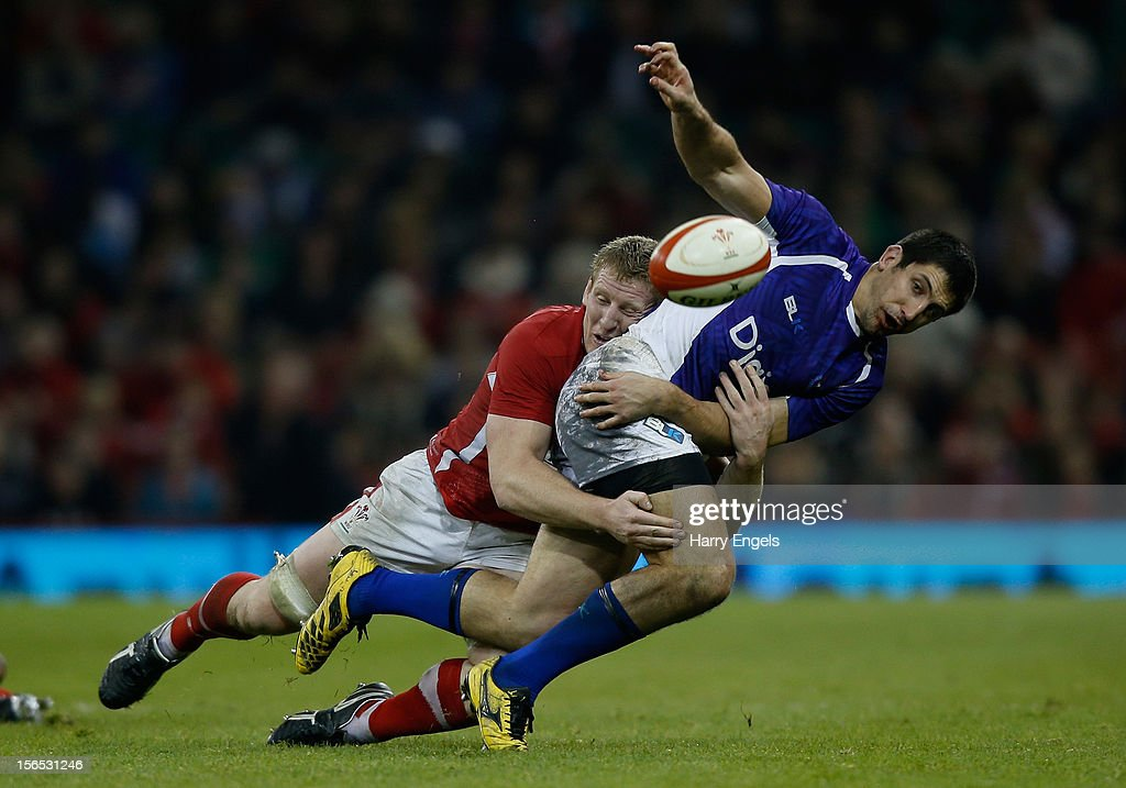 Paul Williams of Samoa offloads the ball as he is tackled by <a gi-track='captionPersonalityLinkClicked' href=/galleries/search?phrase=Bradley+Davies&family=editorial&specificpeople=677663 ng-click='$event.stopPropagation()'>Bradley Davies</a> of Wales during the international match between Wales and Samoa at the Millennium Stadium on November 16, 2012 in Cardiff, Wales.