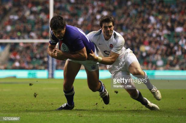 Paul Williams of Samoa scores a try despite the tackle from Ben Foden of England during the Investec Challenge match between England and Samoa at...