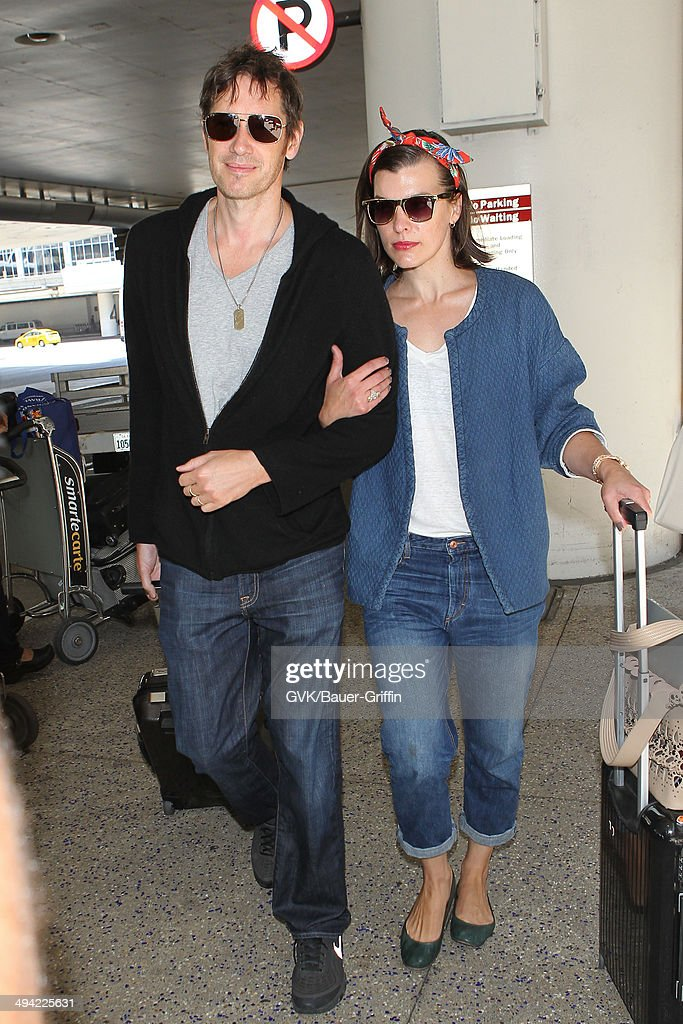 Paul W.S. Anderson and <a gi-track='captionPersonalityLinkClicked' href=/galleries/search?phrase=Milla+Jovovich&family=editorial&specificpeople=202207 ng-click='$event.stopPropagation()'>Milla Jovovich</a> seen at LAX on May 28, 2014 in Los Angeles, California.