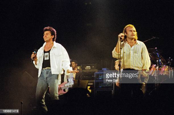 Paul Young and Phil Collins perform on stage at Wembley Arena for The Princes Trust on June 6th 1987 in London England Mike Lindup and Mark King of...
