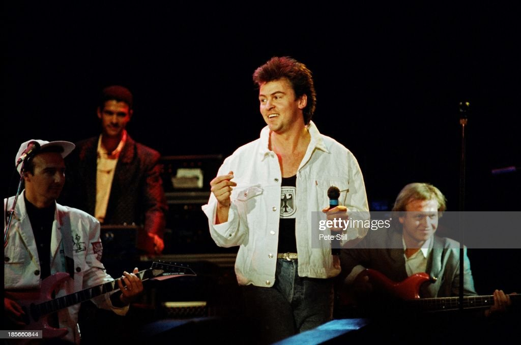 Paul Young performs on stage with Midge Ure of Ultravox and Mike Lindup and Mark King of Level 42 at Wembley Arena for The Princes Trust on June 6th...