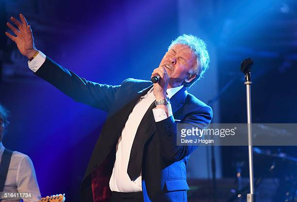 Paul Young perfroms during Gary Barlow's live showcase of 'Fly' an album of songs inspired by the new film 'Eddie the Eagle' at One Mayfair on March...